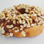 Chocolate Frosted Peanut Topped White Cake Donut
